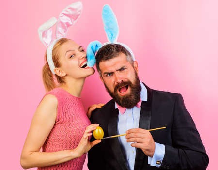 Easter family. Happy Bunny couple with rabbit ears painting eggs.