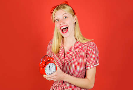 Time. Smiling woman with alarm clock. Beautiful girl with retro alarm-clock. Saving time concept. Black friday. Shopping time. Фото со стока