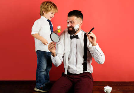 Family relationships. Barbershop. Assistant for dad. Fathers day concept. Son and dad lifestyle. Personal stylist barber.