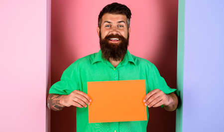Smiling bearded man with little advertising board. Advertising banner with Copy space for text.