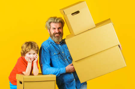 Delivery and family time. Happy son and father with cardboard box.