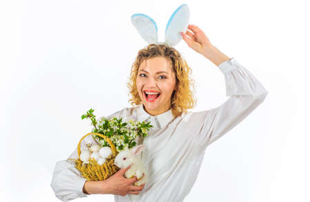 Happy Easter day. Smiling woman with white rabbit and basket with eggs. 版權商用圖片