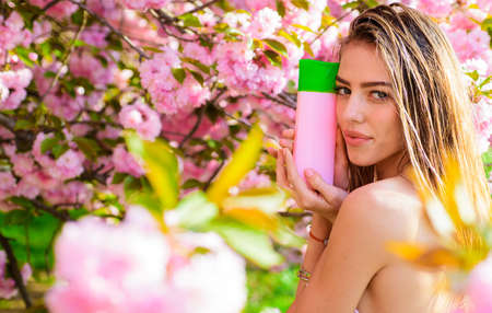 Hair balsam. Shampoo. Conditioner. Beautiful Woman with cosmetic for hair. Hair care.