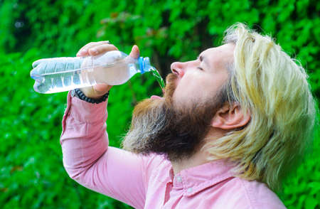 Bearded man drinking water. Hydration concept. Guy with water bottle. Healthy lifestyle.
