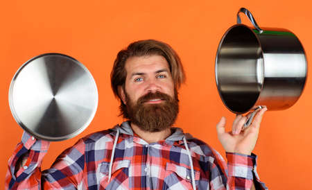 Kitchenware. Cooking utensils. Man with saucepan. Happy chef with cooking pot. Kitchen advertising. Stok Fotoğraf - 166847987