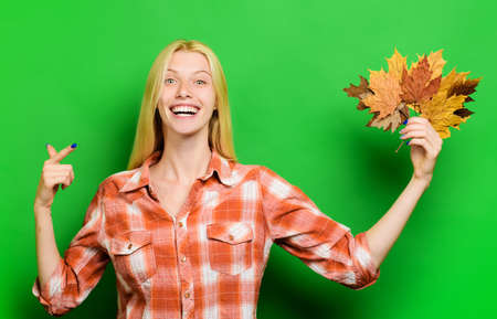 Autumn girl. Happy girl playing with leaves. Smiling woman having fun with Leaf fall. Autumnal mood.