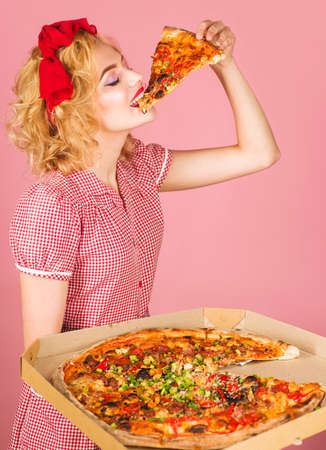 Happy woman eat pizza. Diet, health, fast food, snacks, lunch. Pin-up girl eating pizza.