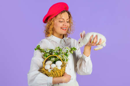 Happy Easter. Happy woman with Basket eggs and bunny rabbit. Tradition of Easter.