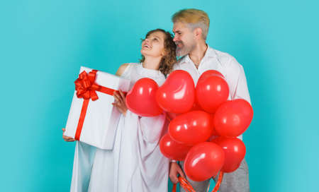 Love. Valentines day couple. Angels with gift and heart shape balloons. Cupid in valentine day. 版權商用圖片