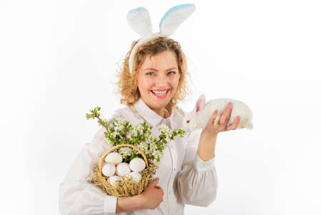 Happy Easter day. Smiling Girl with basket eggs and Easter bunny rabbit. Eggs hunt. 版權商用圖片