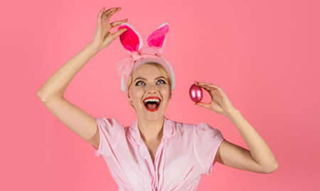 Happy Easter. Beautiful young woman with bunny ears and Easter egg. Hunting eggs. 版權商用圖片