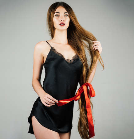 Beautiful model with very long hair. Hairdresser, beauty salon. Hair cosmetics. Hairstyle and health. Standard-Bild