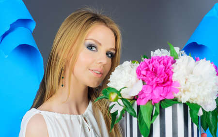 Beautiful Woman with bouquet of peony flowers. Holidays. Valentines day. Womans Day. 版權商用圖片