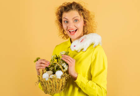 Easter girl with bunny rabbit and basket eggs. Religion symbol. Spring holiday.