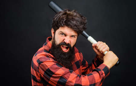 Angry bearded man with baseball bat. Sport equipment. Professional baseball player. Imagens