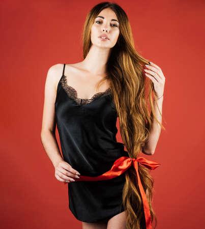 Beautiful woman with long healthy hair. Model girl with very long hair. Hairdresser, beauty salon. Hair cosmetics.
