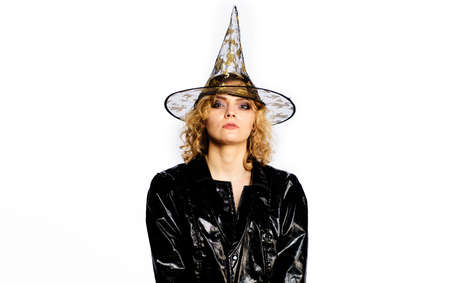 Halloween witch in magic hat. Woman dressing in Halloween costume. Party, Celebrating. Standard-Bild