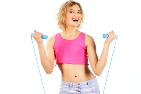 Sporty woman workout with jumping rope. Smiling fitness instructor with skipping rope. Fitness, activity, sport lifestyle. Standard-Bild