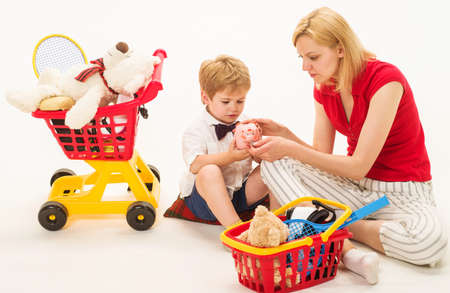 Family relationships. Mother and son playing store. Shopping, discount, sale.