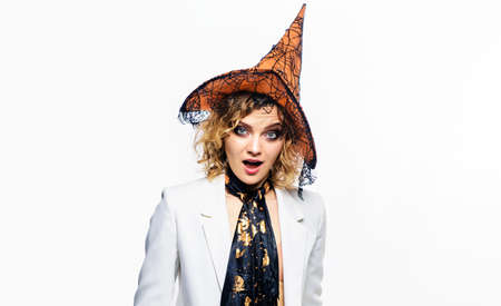 Halloween fashion girl. Surprised woman in Witch hat. Halloween costume. Trick or treat. 31 October.