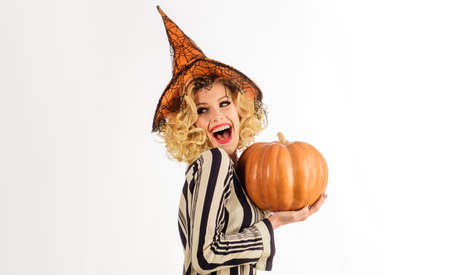 Halloween Party girl. Smiling Witch with Pumpkin. Happy female in Halloween costume.