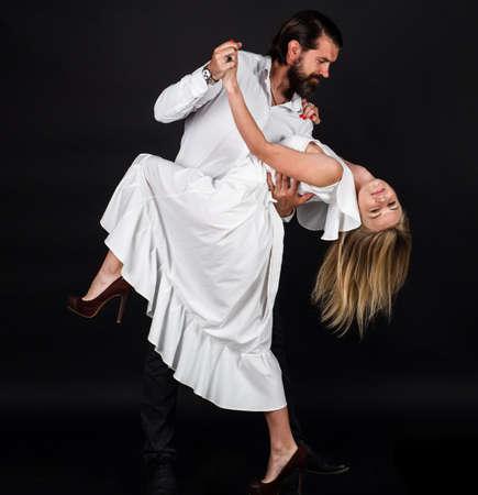 Ballroom dancer couple. Dancing, Salsa, Waltz. Passion and love concept. Standard-Bild