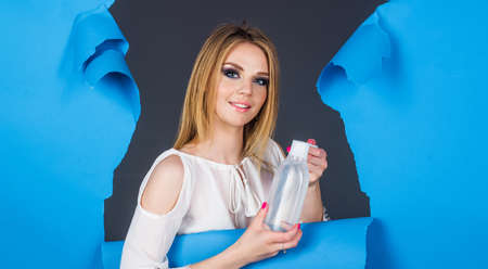 Young woman with micellar water. Happy girl with Face tonic. Makeup remover. Beauty treatment. Advertising for cosmetic product.