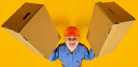Delivery man with cardboard boxes. Shipment. Delivery from shop. Smiling Bearded man with box.
