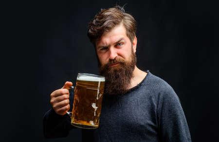 Oktoberfest celebration. Stylish Bearded man with mug of craft beer. Drinks, alcohol, leisure, people concept.