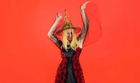 Halloween fashion woman. Smiling girl in halloween costume and Witch hat. Trick or treat. 31 October.
