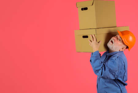 Man with cardboard boxes. Fast and free Delivery transport. Online shopping. Express delivery. Shipment. Copy space. Standard-Bild