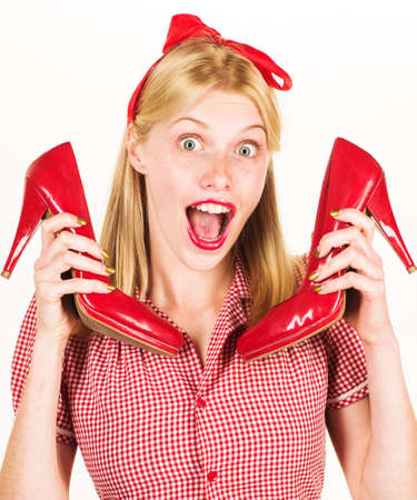 Happy woman with red shoes. Shopping. Discount and sales. Beauty and fashion. Shoes sale. Advertising. Standard-Bild