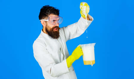 Bearded man in rubber gloves with cleaning solution or soap liquid. Disinfecting home. Domestic cleaning. Cleaning Service Worker. Standard-Bild