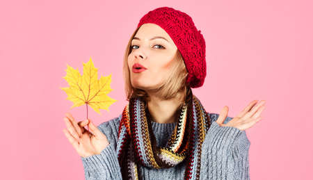 Autumn time. Woman in warm clothes with leafs. Sexy girl in sweater, hat and scarf. Sales. Discount.