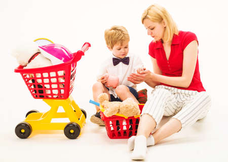 Cute mother and child boy plays together. Family relationships. Playing supermarket. Mother play with son.