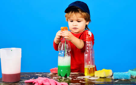 House cleaning and household duties. Little boy Playing with cleaning spray. Cleaning supplies.