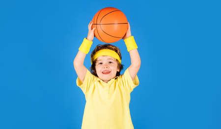 Basketball training. Little basketballer. Cute child boy playing basketball. Sport game. Sports equipment.