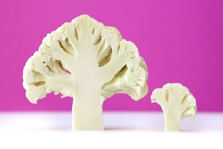 Cross section of cauliflower on pink bacground