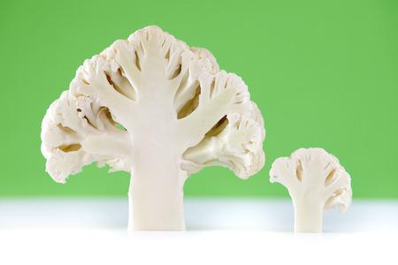 Cross section of cauliflower on green bacground Stock Photo