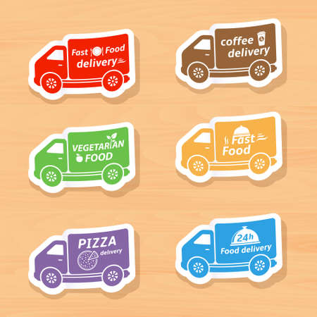 web element: Fast food delivery car labels on wooden background.