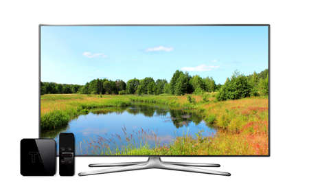 Smart tv and multimedia box with remote controller and landscape wallpaper on screen
