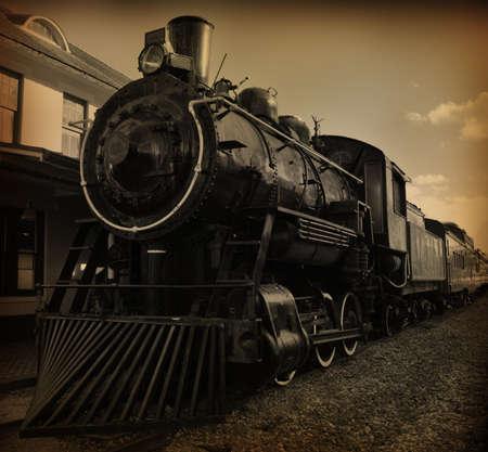 세피아 톤 샷의 오래 된 구식 된 증기 기차 스톡 콘텐츠
