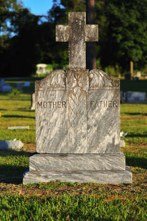 intended: Headstone with stone cross intended for a parental burial plot Stock Photo