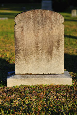 Blank Tombstone in a cemetery ready for text Stock Photo