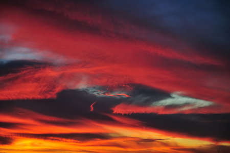 saturated: Extremely bright and saturated colors in clouds at sunset