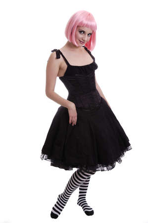 Photo of an atrractive young goth girl with pink hair isolated on white 免版税图像
