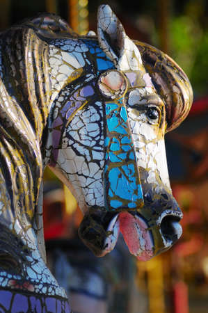 merry go round: Weathered carousel horse with shallow depth of field Stock Photo