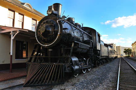 Old steam train at station
