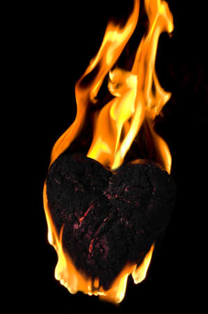smoldering: photo of a Heart shaped charcoal on fire