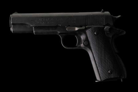 45 gun: hand gun isolated on black Stock Photo